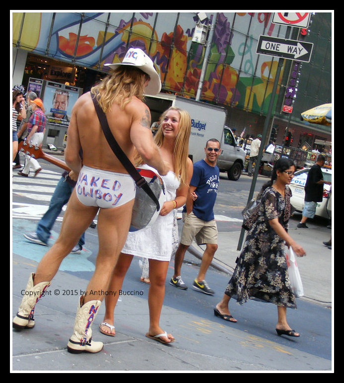 Naked Cowboy meets Times Square tourist.